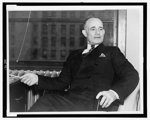 Napoleon_Hill_seated_in_chair
